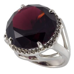 Bold and beautiful 14k white gold 25ct Round Garnet with a diamond bezel.
